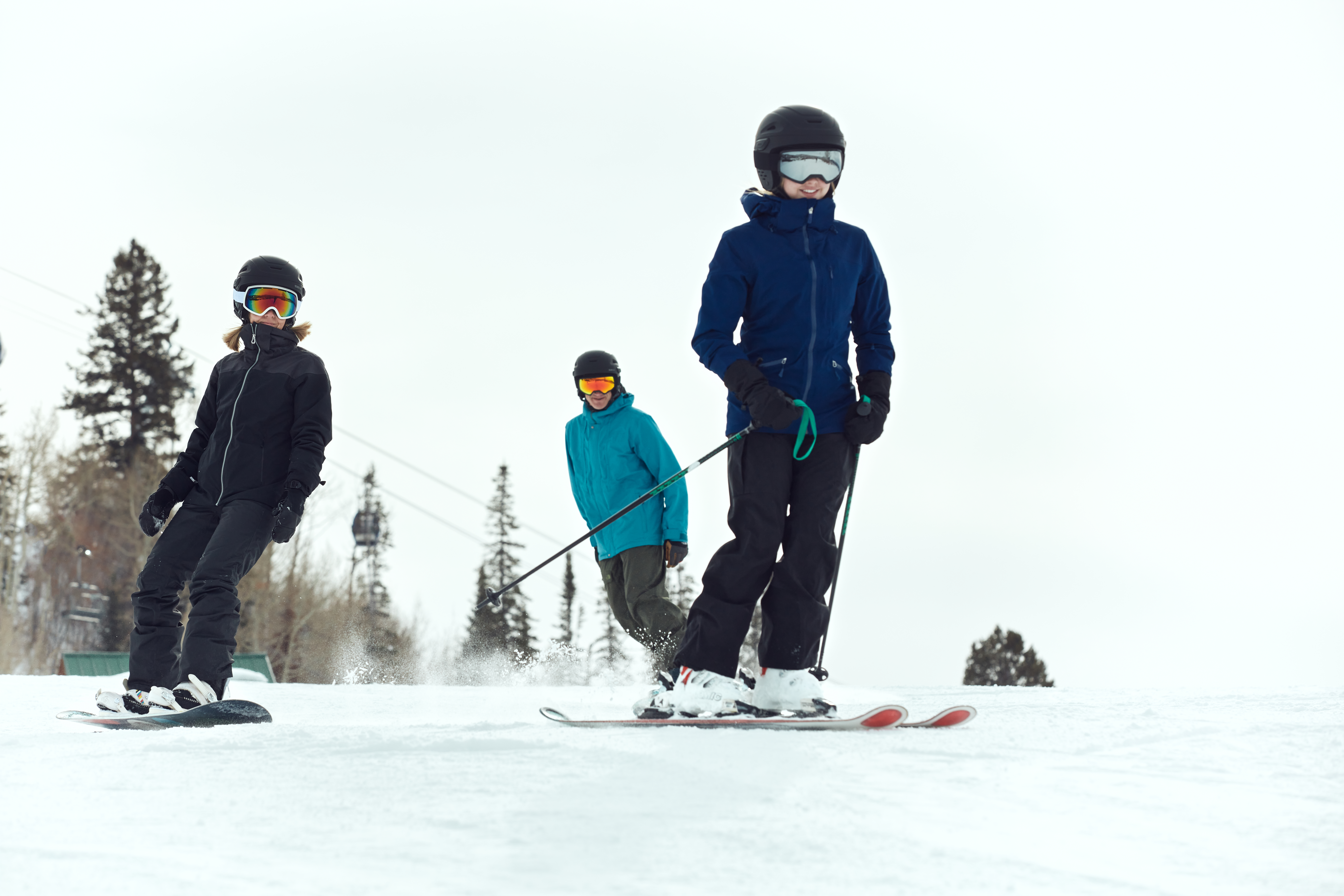 Skiers with the Latitude helmet